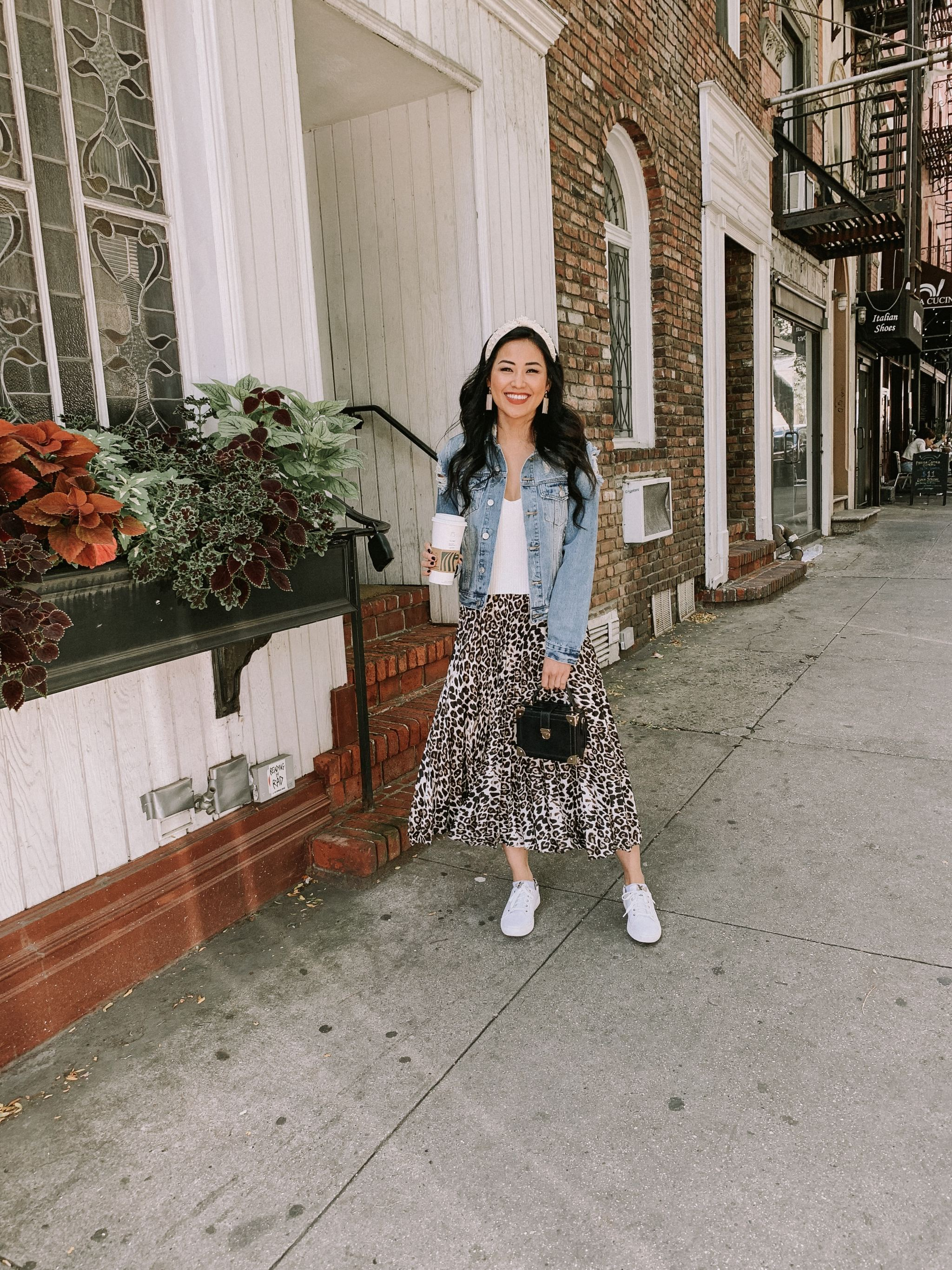 NYFW street style leopard skirt denim jacket white tennis shoes fall outfit