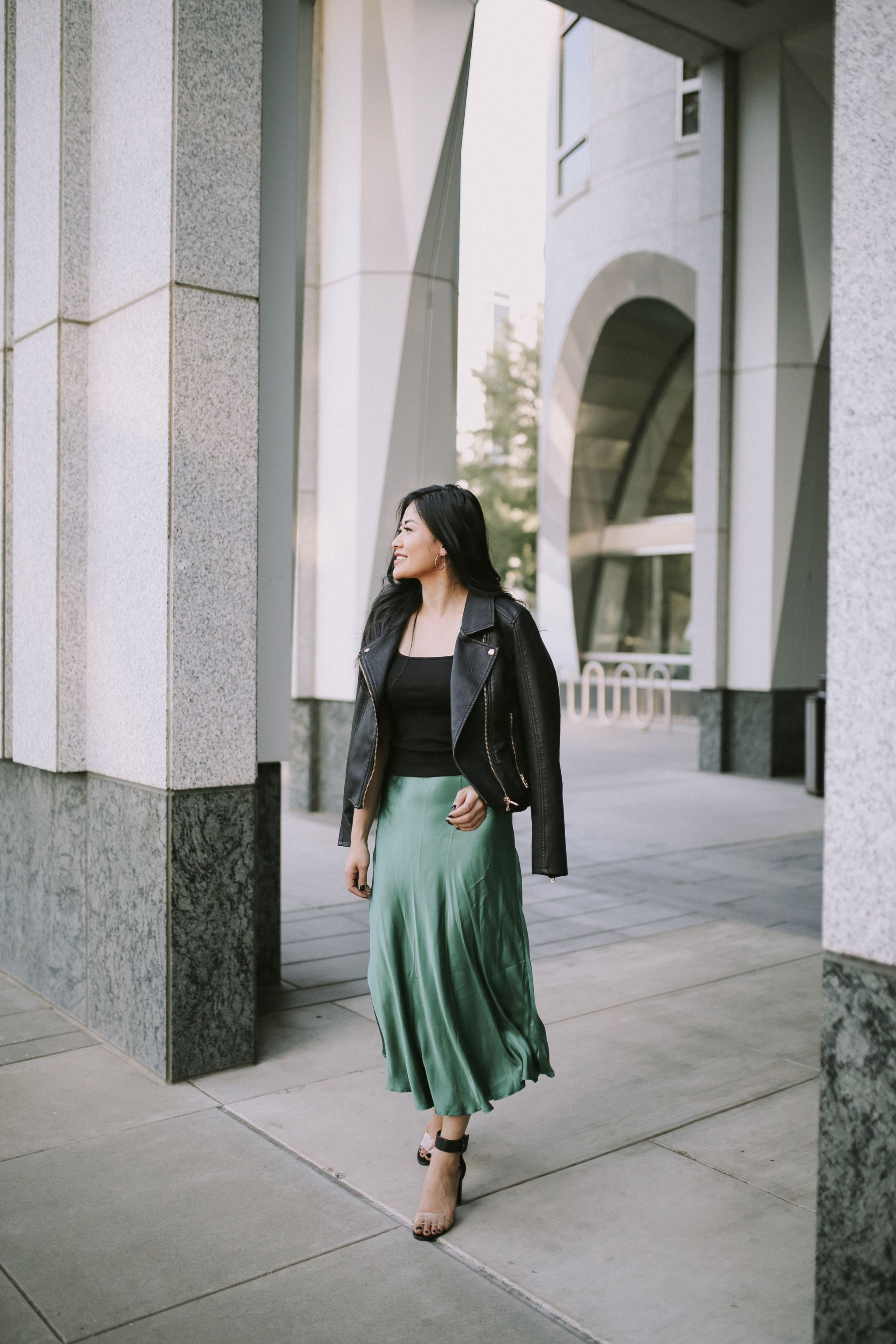 green skirt black leather jacket holiday outfit fall outfit