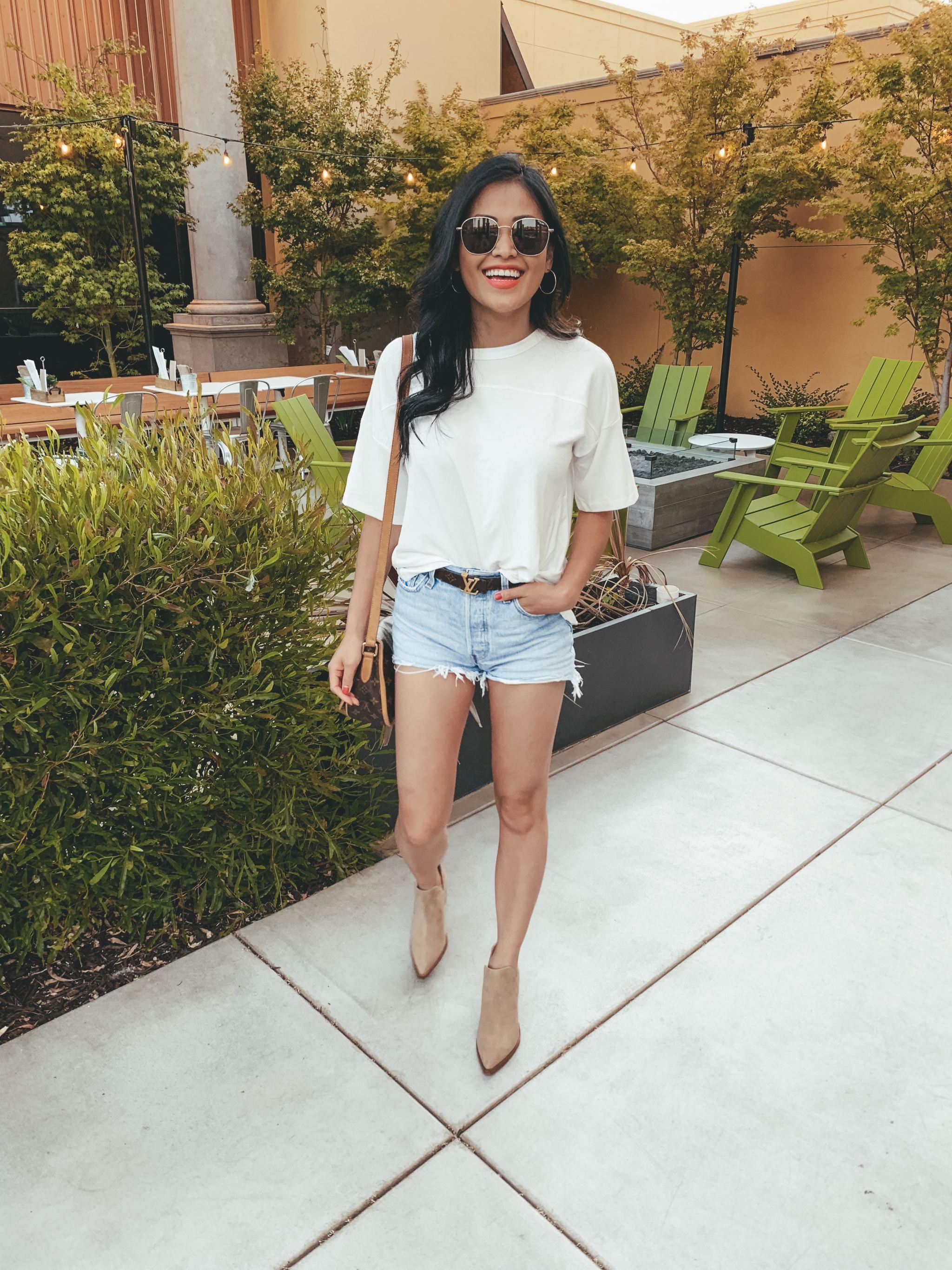 "alt=""piecesofemerald.com womens white oversized shirt louis vuitton reversible belt levis denim shorts vince camuto camel suede booties"""