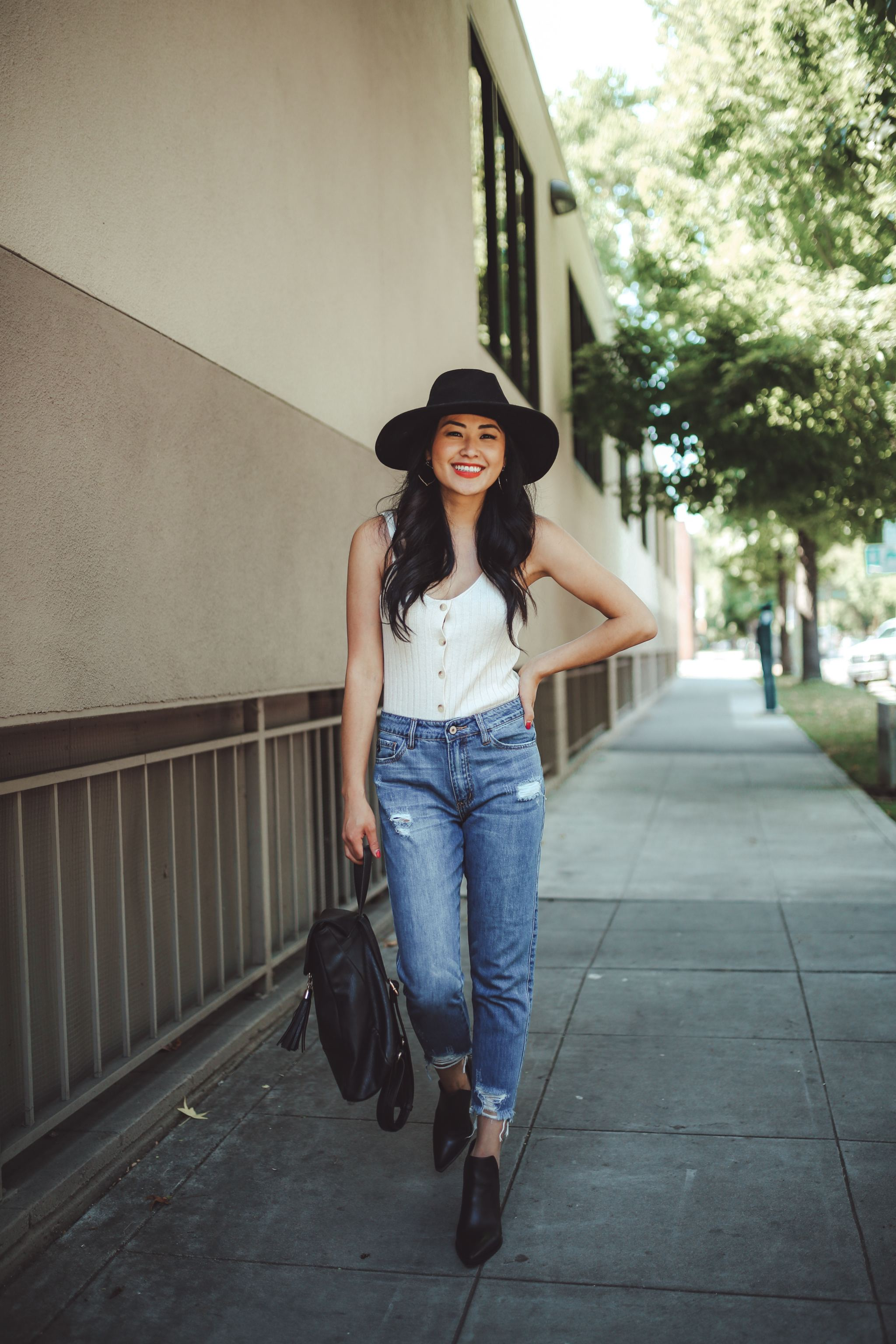 "alt=""piecesofemerald.com womens ribbed ivory tank top black suede hat black booties highways jeans with black backpack"""