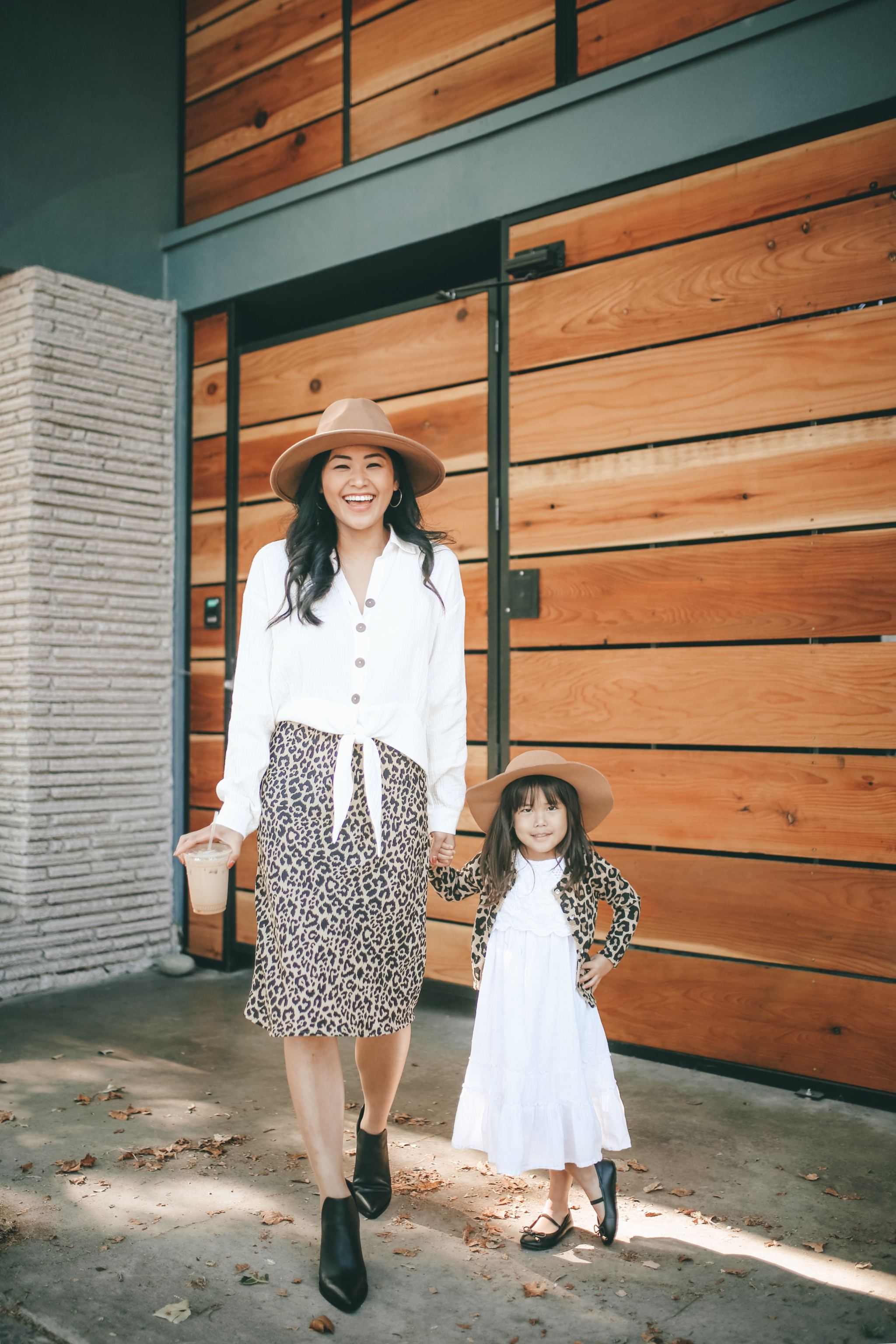 "alt=""piecesofemerald.com mommy and me photo womens white buttoned up shirt leopard skirt black booties toddler white dress toddler leopard cardigan"""