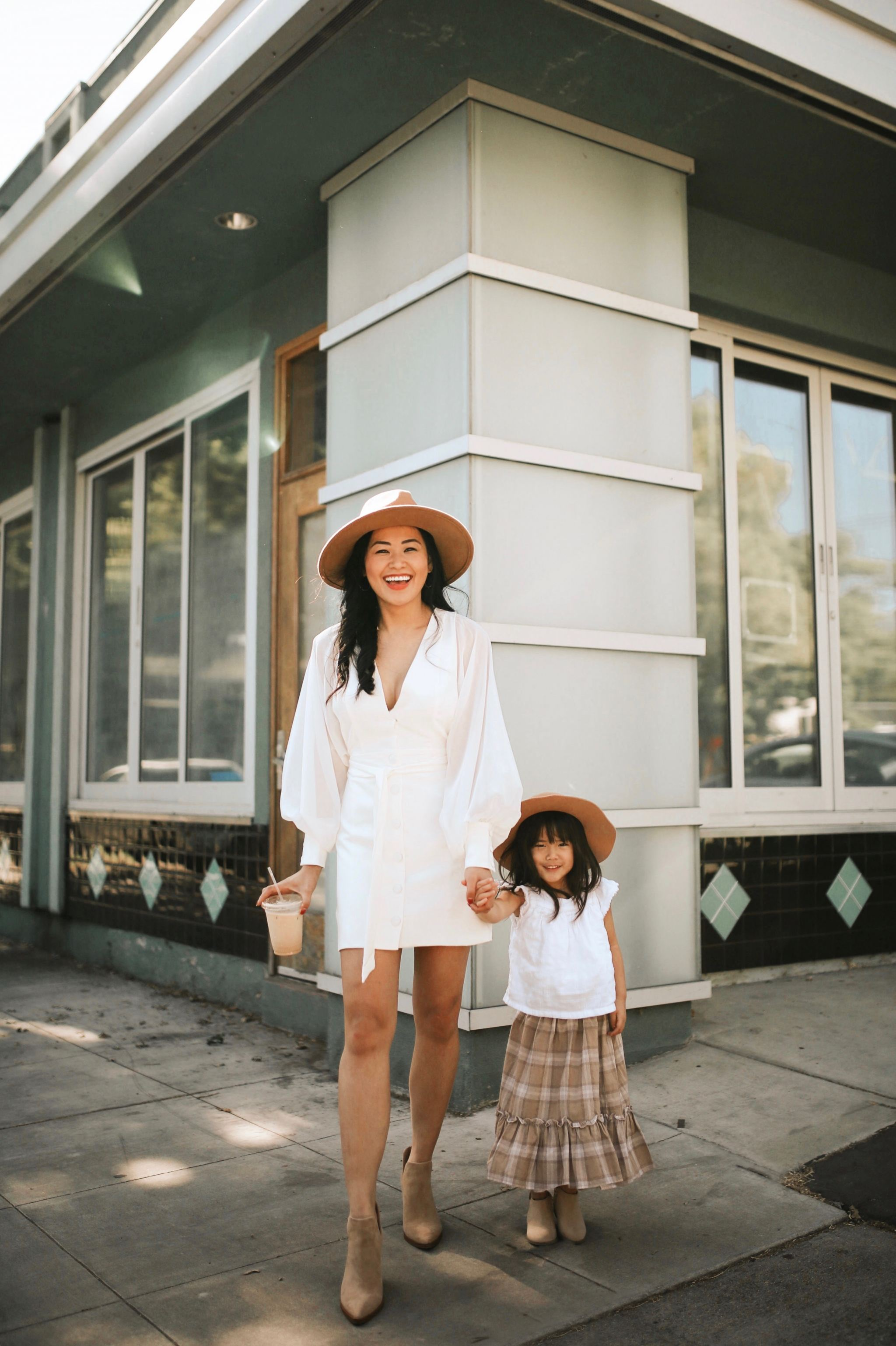 "alt=""piecesofemerald.com long sleeve white dress with booties camel hat mommy and me sacramento photo toddler white flutter sleeve top toddler brown plaid skirt toddler camel hat toddler brown suede booties"""