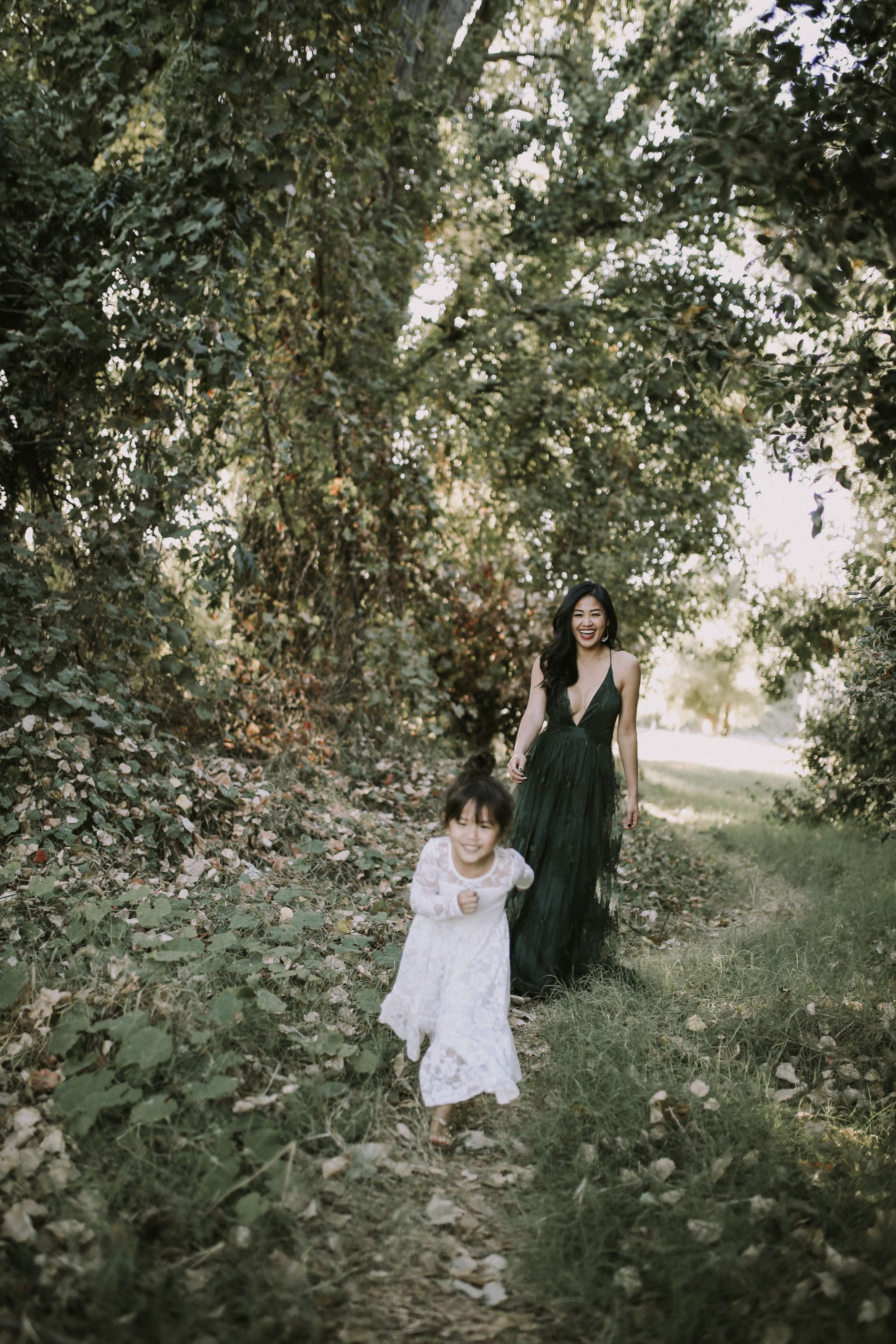 toddler running photo with white lace dress